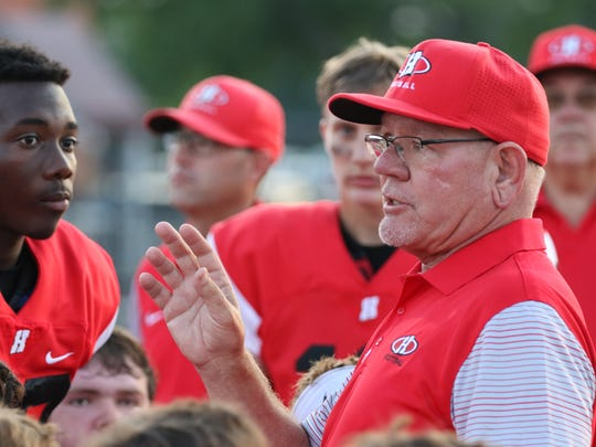Homestead's Head Coach Dave Keel talks with his players before the start of a game against Port Washington at home on Aug. 18.
