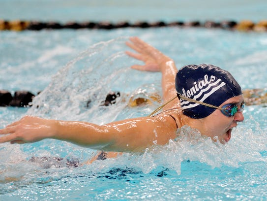 New Oxford's Rachel Groden swims the 100-yard butterfly