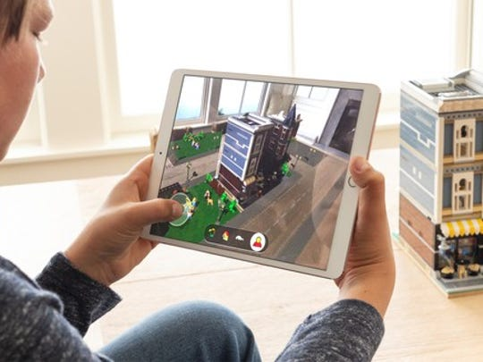 Person using augmented reality with Legos
