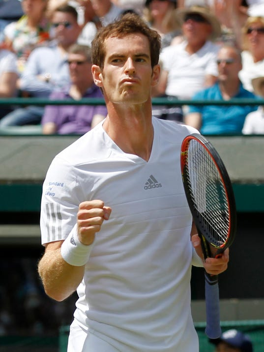 Andy Murray of Britain celebrates after winning a point against Biaz Rola of Slovenia during their men's singles match at the All England Lawn Tennis Championships in Wimbledon, London, Wednesday, June 25, 2014. (AP Photo/Sang Tan)