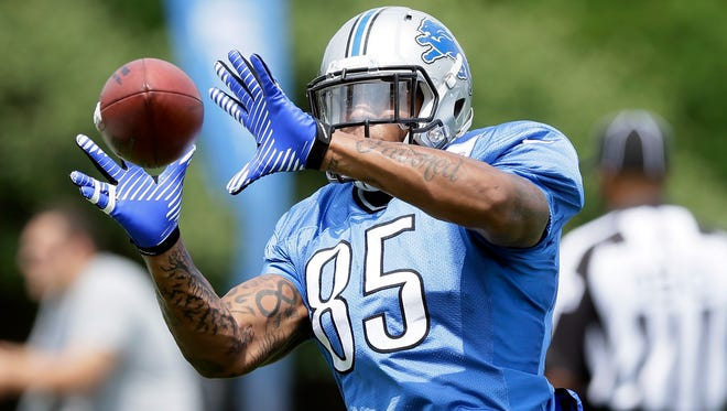 Detroit Lions tight end Eric Ebron runs through drills during a training camp in Allen Park on July 31, 2014.