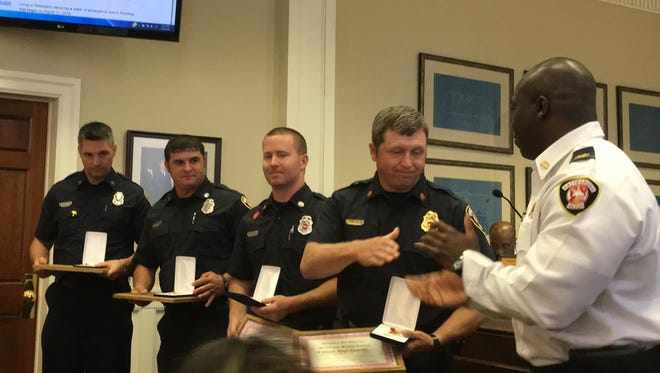 Hattiesburg fire Capt. Matt Saucier, engineer Sam Caldwell, and firefighters Matt Patterson and Ricky Sheppard were honored by Chief Paul Presley at Monday's Hattiesburg City Council work session for their swift-water rescue work during a flood on March 11. Four people were rescued from a vehicle that had been washed off the road.