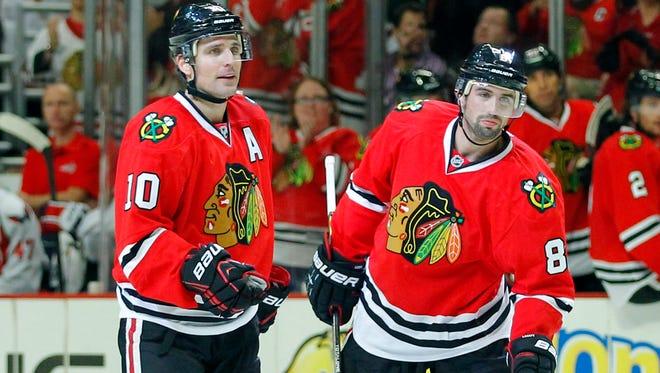 Veteran center Patrick Sharp and young defenseman Nick Leddy exemplify the mix that has keyed the Blackhawks' success over the past several seasons.