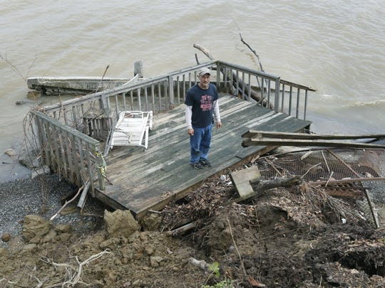 Rick Davis stands on a deck that was destroyed by Lake Ontario's high level of water at his lakefront property in Hamlin.