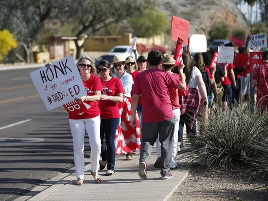 Teachers protest outside the KTAR studios in Phoenix