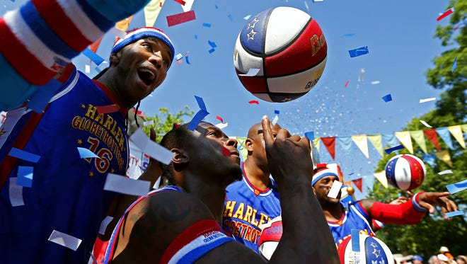 The Harlem Globetrotters perform during the 90th Birthday Party event for the team at Silver Dollar City in Branson, Mo. on June 11, 2016.
