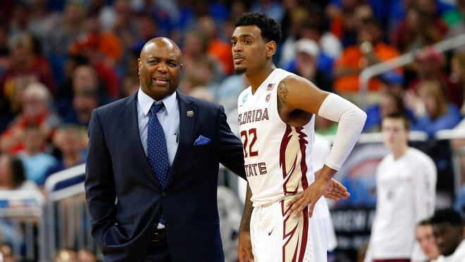 Florida State men's basketball coach Leonard Hamilton talks with guard Xavier Rathan-Mayes during the second half of the Seminoles' second-round NCAA tournament game.