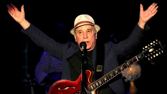 American songwriter and producer Paul Simon performs in 2013. Simon & Schuster, announced Tuesday, Nov. 4, 2014, that Simon has agreed to cooperate with author and longtime music critic Robert Hilburn for a planned biography.