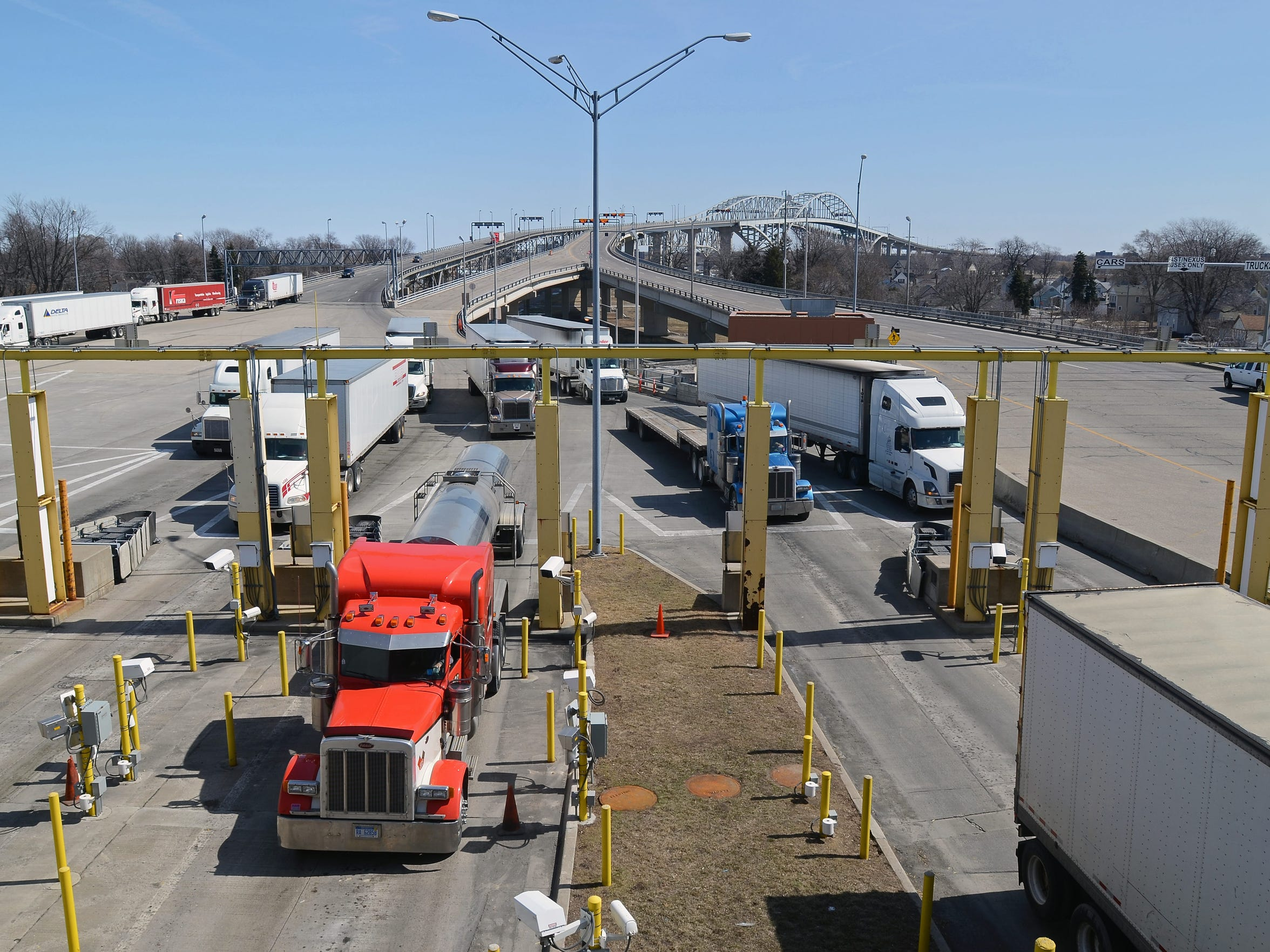 Trucks enter the customs checkpoint several years ago at the Blue Water Bridge Plaza in Port Huron. ANDREW JOWETT/TIMES HERALD.