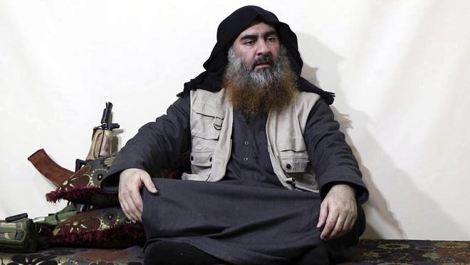 This image made from video posted on a militant website on Monday, April 29, 2019, purports to show the leader of the Islamic State group, Abu Bakr al-Baghdadi, being interviewed by his group's Al-Furqan media outlet.