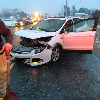 A vehicle involved in a near head-on crash with another