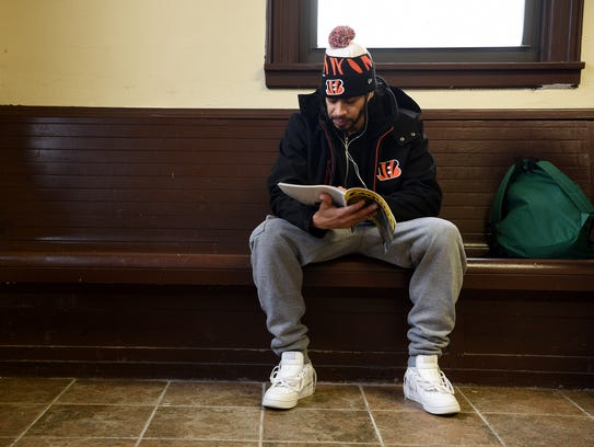 Adam Miranda of Paterson waits for his train at the