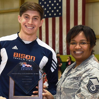 Bucknell University's Andrew Garcia-Garrison (left) was presented with the Patriot League's Indoor Track and Field MVP award after figuring in four first-place finishes.