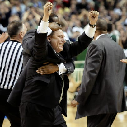 Michigan State head coach Tom Izzo is picked up by