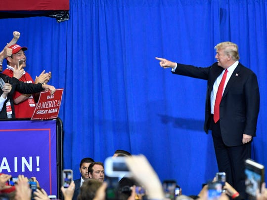 President Donald Trump points to the crowd during a rally at Municipal Auditorium, Tuesday, May 29, 2018, in Nashville, Tenn.