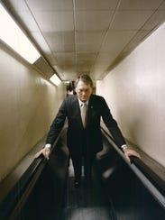 NOVEMBER 1, 1983: Jim Bunning uses an escalator in