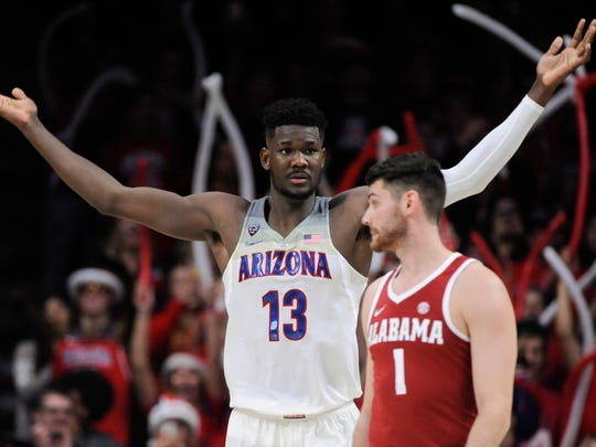 Arizona Wildcats forward Deandre Ayton (13) celebrates beating Alabama last week.