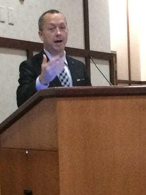 Mayor Dave Snow addresses those gathered for a community discussion about food insecurity Tuesday at Reid Health.