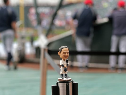A bobblehead of New York Yankees great Lou Gehrig stands on a stanchion during the Yankees batting practice prior to a baseball game against the Minnesota Twins, Friday, July 4, 2014, in Minneapolis. The Yankees are commemorating the 75th anniversary of Gehrig's famous farewell speech.  (AP Photo/Jim Mone)