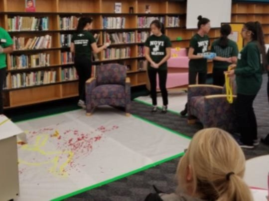 Novi High School students process the crime scene.