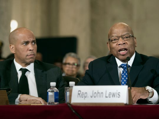 Sen. Cory Session, D-N.J., (left) listens at left as Rep. John Lewis, D-Ga. testifies Wednesday, Jan. 11, 2017 on Capitol Hill in Washington at the second day of a confirmation hearing for Attorney General-designate, Sen. Jeff Sessions, R-Ala., before the Senate Judiciary Committee.