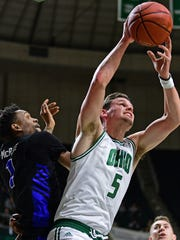 Ohio forward Ben Vander Plas pulls in a rebound next to Buffalo forward Montel McRae during the first half of an NCAA college basketball game Tuesday, March 5, 2019, in Athens, Ohio. (AP Photo/David Dermer)