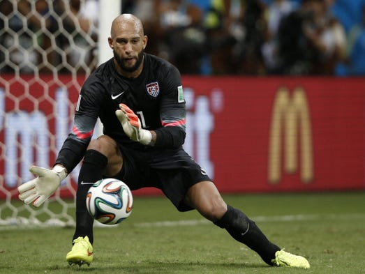 US goalkeeper Tim Howard makes a save during extra-time in the Round of 16 football match between Belgium and USA at The Fonte Nova Arena in Salvador on July 1, 2014, during the 2014 FIFA World Cup.