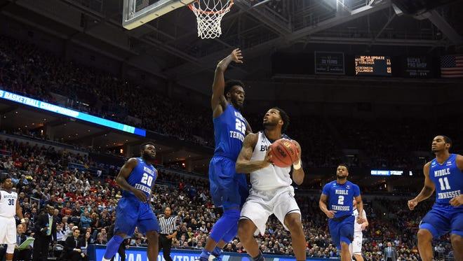 Butler forward Tyler Wideman goes up for a shot while Middle Tennessee forward JaCorey Williams defends.