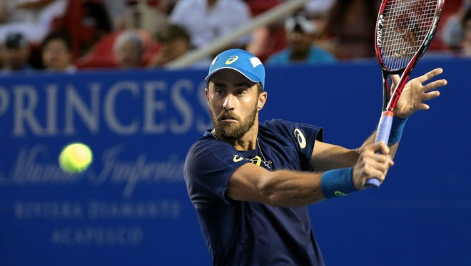 Steve Johnson of the USA in action against John Isner of the USA during their Mexican Open match in Acapulco, Mexico.