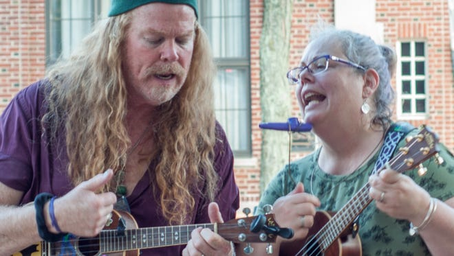 Members of the Somerville Ukulele Experience, John Fitzpatrick of Somerville and Becca Kaian of Madison, are pictured busking in Madison. The pair founded the community music-minded Coffeehouse Project and  Make Music Somerville, part of a global songfest held annually on June 21.