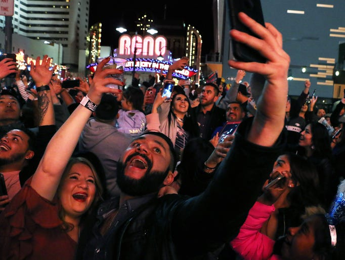 People celebrate New Year's Eve in downtown Reno on