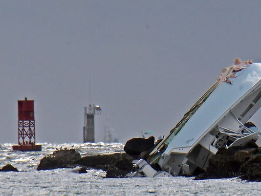 """FILE - In this Sept. 25, 2016, file photo, a boat lies overturned on a jetty off Miami Beach, Fla., in a crash that killed Miami Marlins starting pitcher Jose Fernandez and two others. Toxicology reports show Fernandez had cocaine and alcohol in his system when his boat crashed into a Miami Beach jetty. The cause of death was listed as """"boat crash"""" in the autopsy report released Saturday, Oct. 29, 2016, by the Miami-Dade County Medical Examiner's Office. (Patrick Farrell/Miami Herald via AP, File)"""