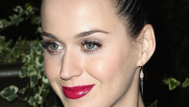 Katy Perry, a master tweeter, advises against self-indulgence and excessive self-promotion on social media.