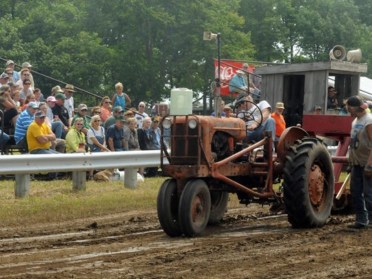 Dan Diedrich tries to keep 'er moving during last year's antique tractor pull competition at the Valmy Thresheree.