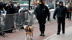 Boston Police officers patrol outside federal court
