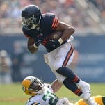 Bears running back Matt Forte tries to avoid a tackle by Ha Ha Clinton-Dix during the first quarter at Soldier Field.