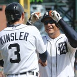 Detroit Tigers' Miguel Cabrera, right, is congratulated by teammate Ian Kinsler after they both scored on Cabrera's two-run home run during the seventh inning of a baseball game against the Minnesota Twins, Thursday, May 14, 2015, in Detroit. (AP Photo/Carlos Osorio)