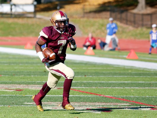 Iona Prep's Ki'Shyne Shipmon finds a path against Fordham Prep to score a touchdown in the quarterfinals of the Catholic High School Football League Nov. 6, 2016 at Iona Prep in New Rochelle. Iona Prep won, 41-0.