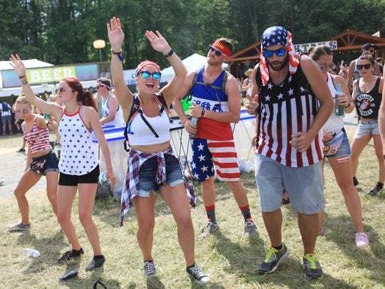 Fans dance to Waka Flocka Flame at the Backyard Stage
