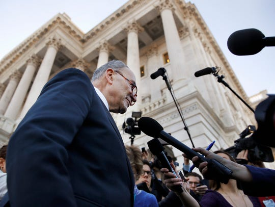Senate Minority Leader Chuck Schumer, D-N.Y., center, speaks to the media Friday outside the Capitol after meeting with President Donald Trump. AP Photo/Jacquelyn Martin