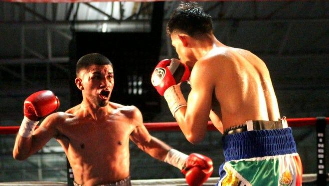Joel Garcia, left, fights against Oscar Mojica.