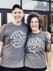 Pictured is  Shawn Bray, who was helped by the Grey Matters Fund, and Miichael Harris, co-founder of the fund, at last year's Grey Matters Walk.