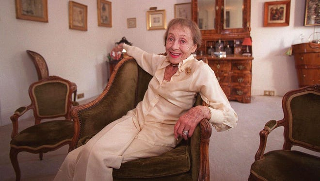 """Luise Rainer poses in her central London apartment on July 29, 1999. Rainer, a star of cinema's golden era who won back-to-back Oscars but then walked away from a glittering Hollywood career, has died. She was 104.  Rainer's daughter, Francesca Knittel-Bowyer, told The Associated Press her mother died Tuesday, Dec. 30, 2014.  In 1936 and 1937, Rainer was the first performer ever to win back-to-back Academy Awards, for """"The Great Ziegfeld"""" and """"The Good Earth."""""""