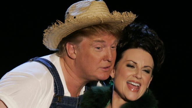 Donald Trump and Megan Mullally on stage at the Shrine Auditorium.