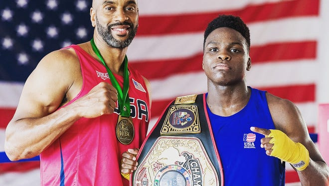 Trainer Don Somerville (left) and 19-year-old boxer Aadam Ali of Teaneck.