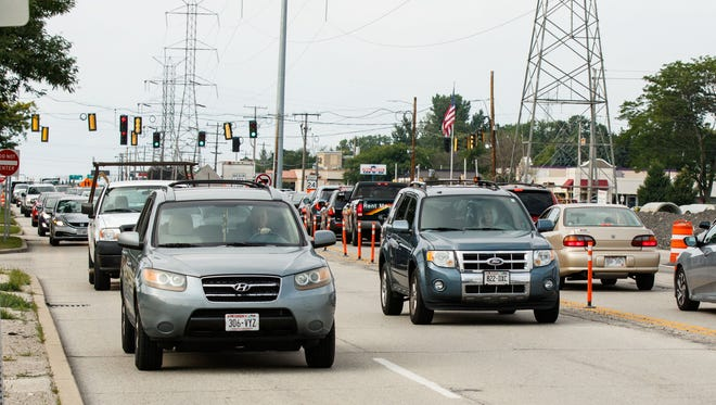 View of rush hour traffic on Highway 100 looking north at intersection of West Grange Ave. on Monday afternoon, July 23, 2018.