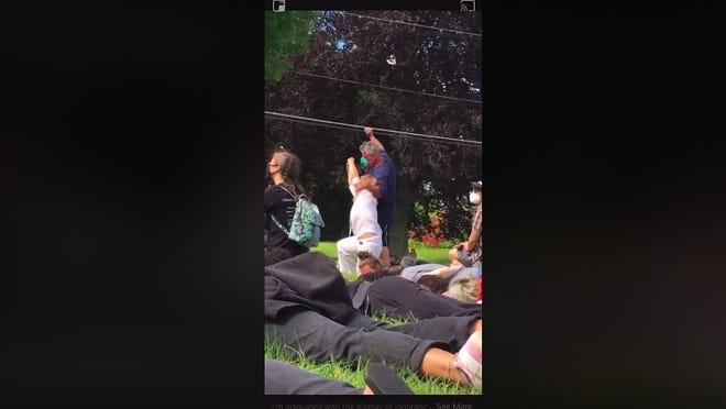 A man witnesses say is Milford Police Sgt. Jim Heron is pictured in a Facebook video during the demonstration and vigil on Sunday. He appeared to be intoxicated, according to attendees.