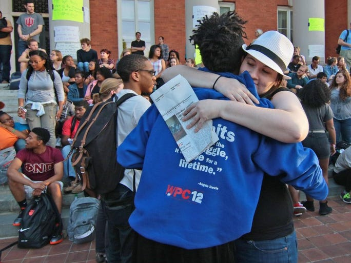 D.J. Smith (left), one of five Clemson University students released after getting a citation for trespassing in Sikes Hall, gets a hug from supporter Zoe Anzola on the front steps of Sikes Hall. Students protested over exclusion, racial insensitivity, and administrative inaction at the university.