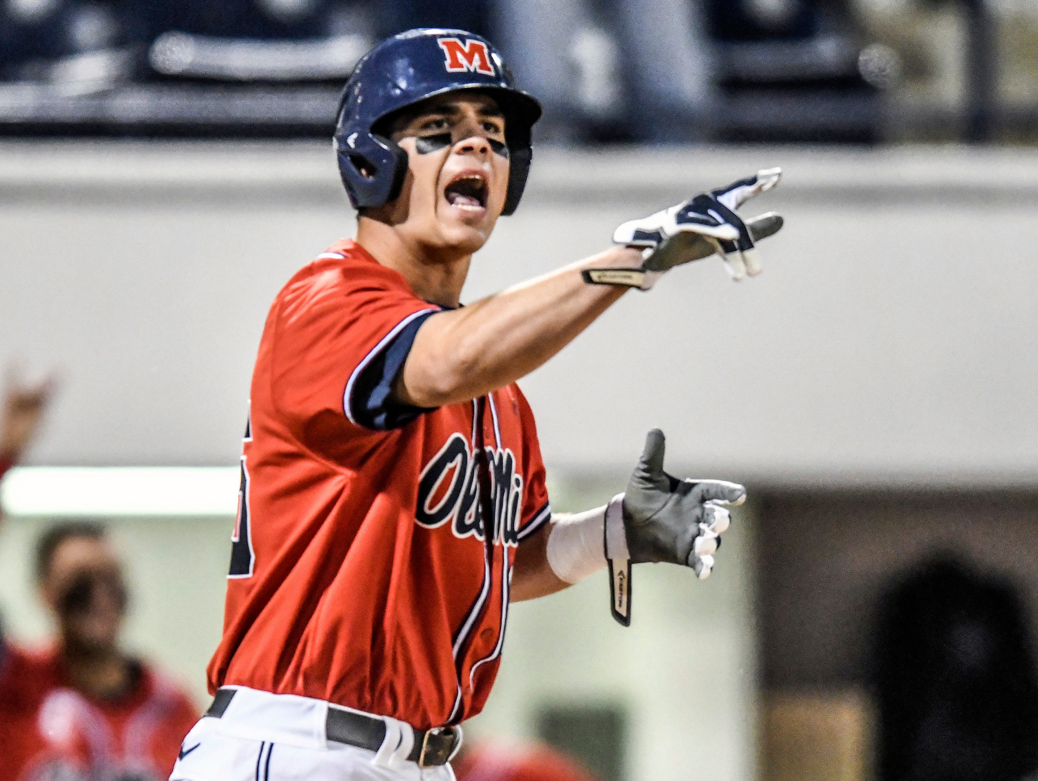 Ole Miss' Colby Bortles (25) posted two hits and scored a run in the Rebels' SEC opener.