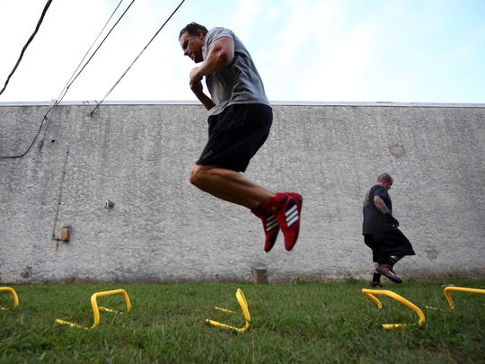 Students work on speed and agility training outside at adult boxing class at Gladiator Fitness in Lacey.